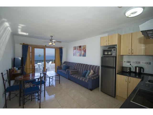 Living room opens onto balcony - Tenerife Apartments, San Eugenio, Tenerife